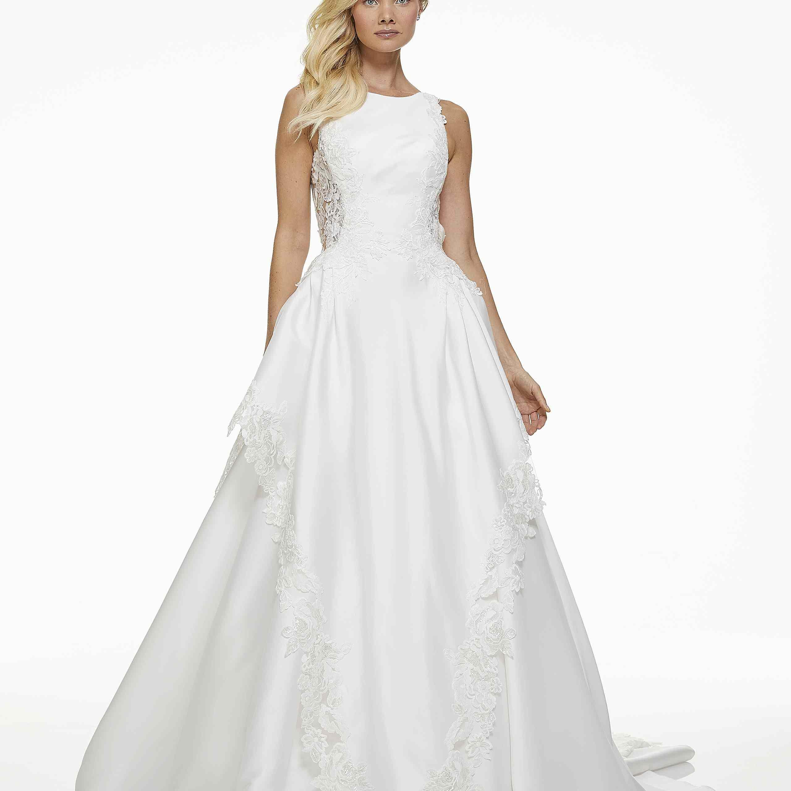 Model in sleeveless boat neck wedding ball gown