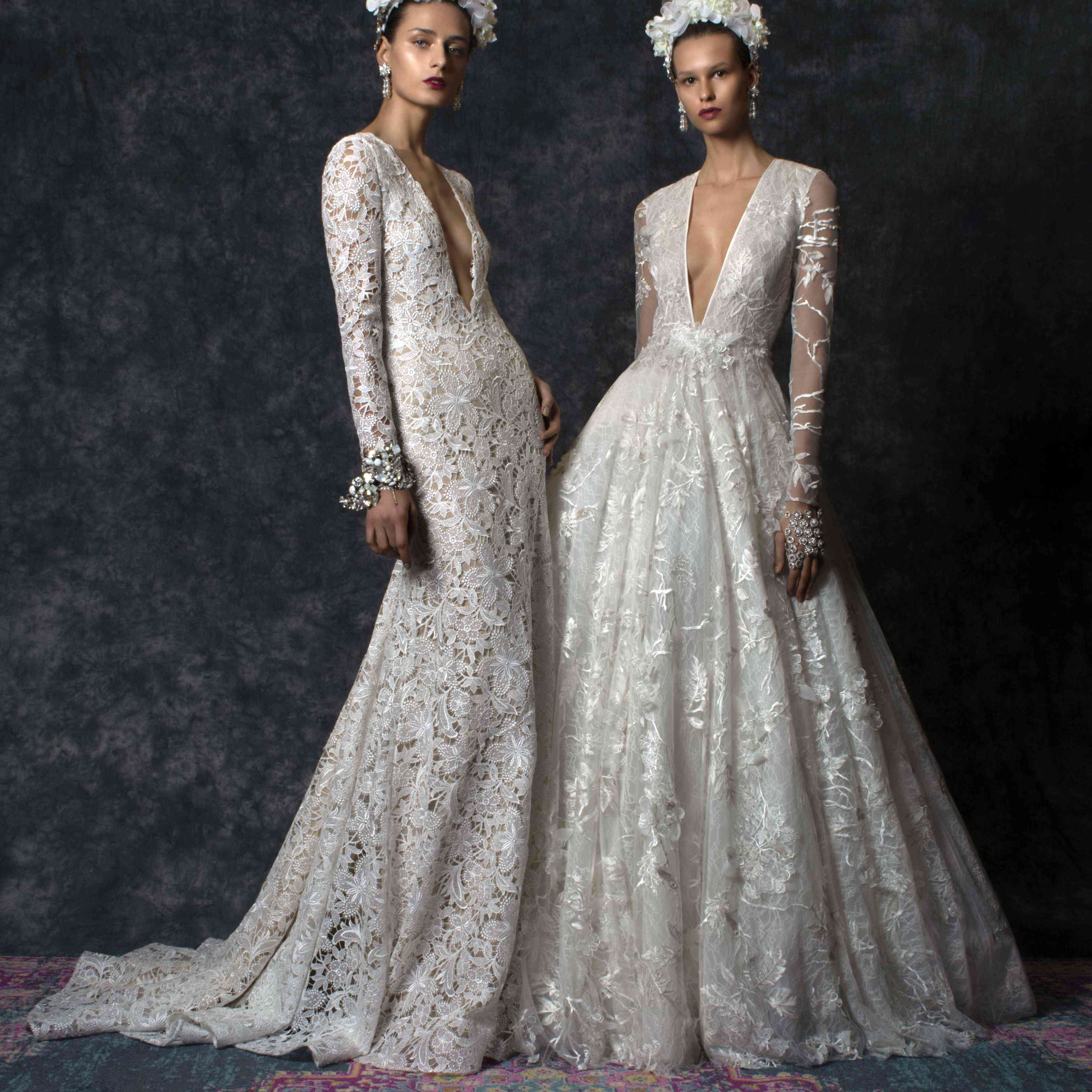 Two models side by side in long-sleeve floral wedding gowns