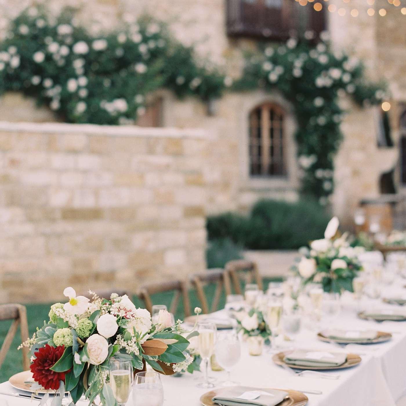<p>A minimal tablescape with assorted floral arrangements.</p>