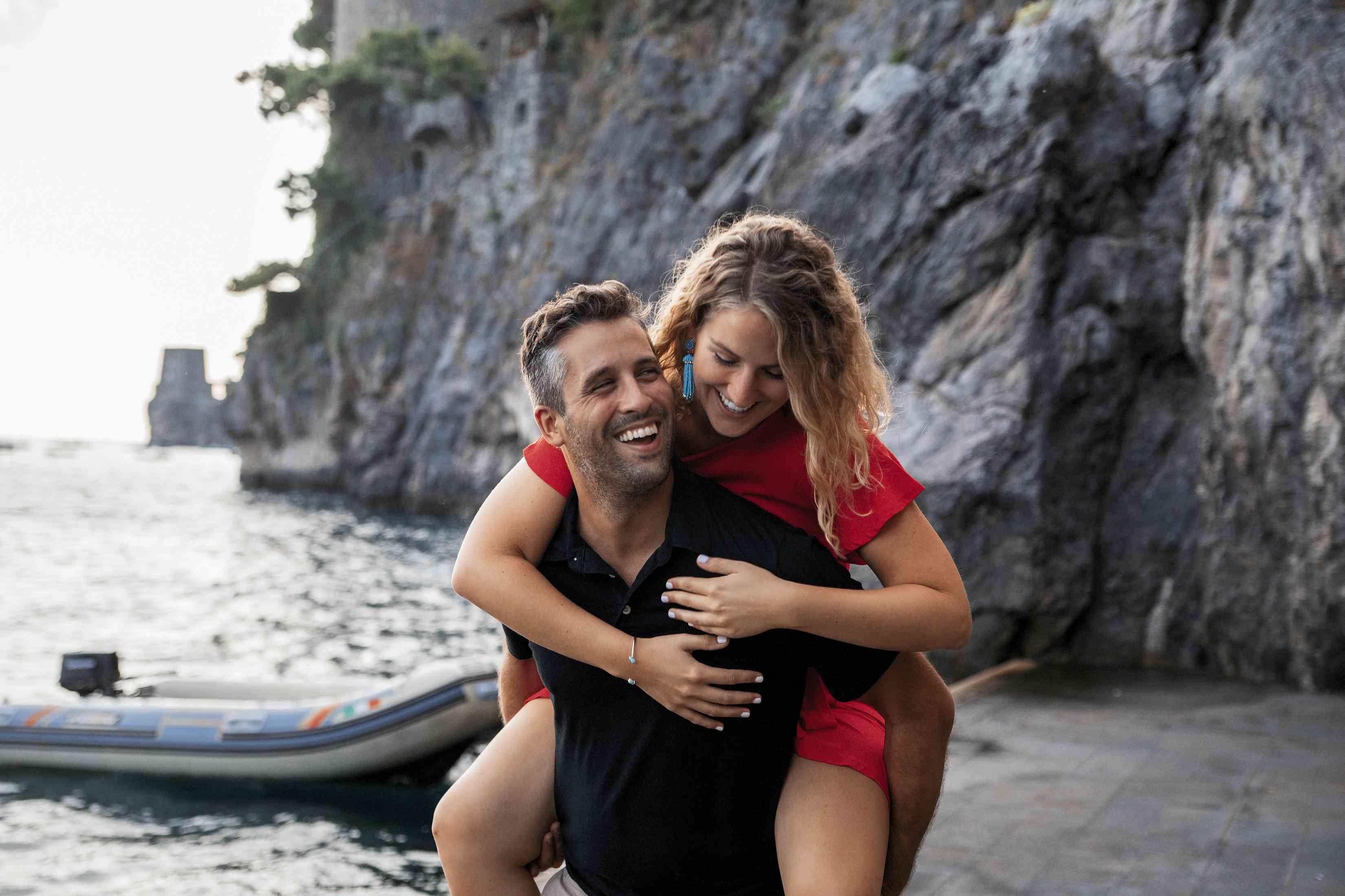 Man holding woman by a lake