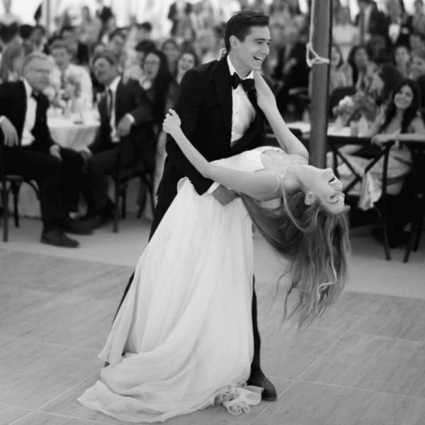 Groom dipping bride as they have their first dance at their wedding