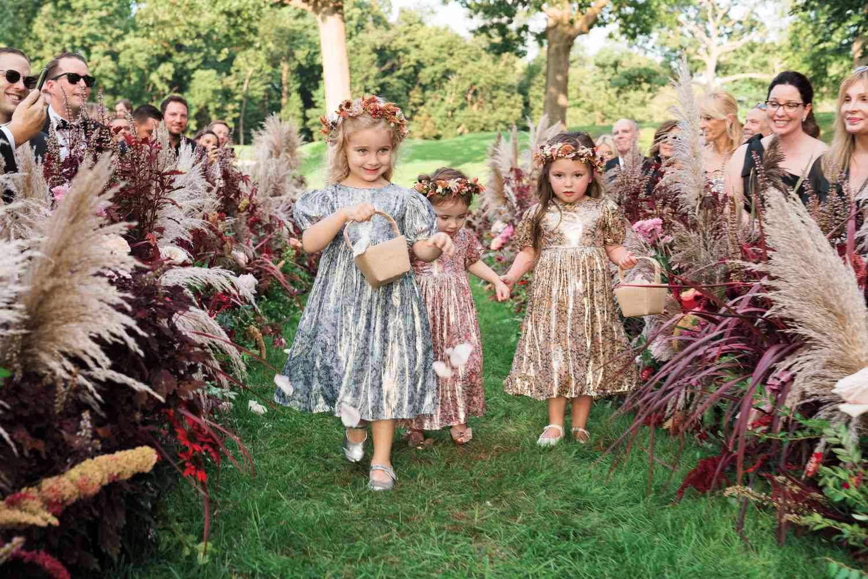 flower girls walking down the aisle