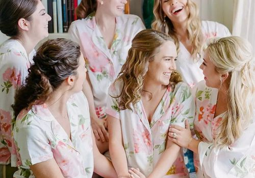 Bride and her bridesmaids wearing floral pajama sets and robes