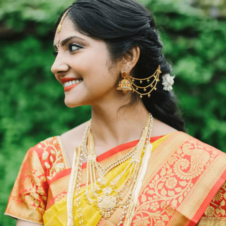 South Asian bride with taupe eyeshadow and vibrant lip