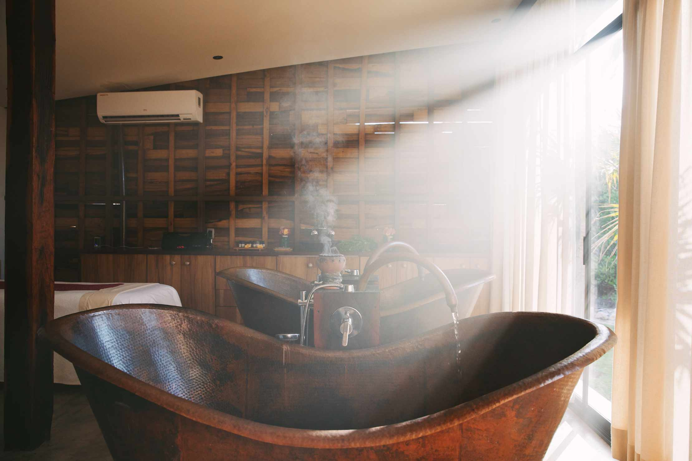 Large bathtubs with water and steam