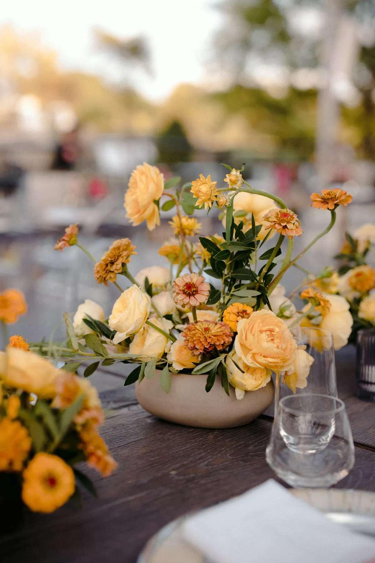 yellow hued flower centerpiece