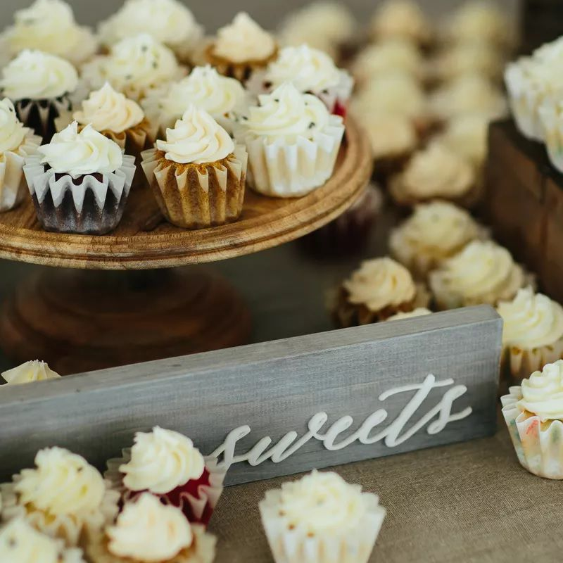 Mini cupcakes on a wedding display