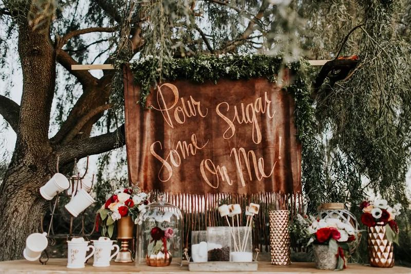 Pour some sugar on me hot cocoa bar for outdoor winter wedding