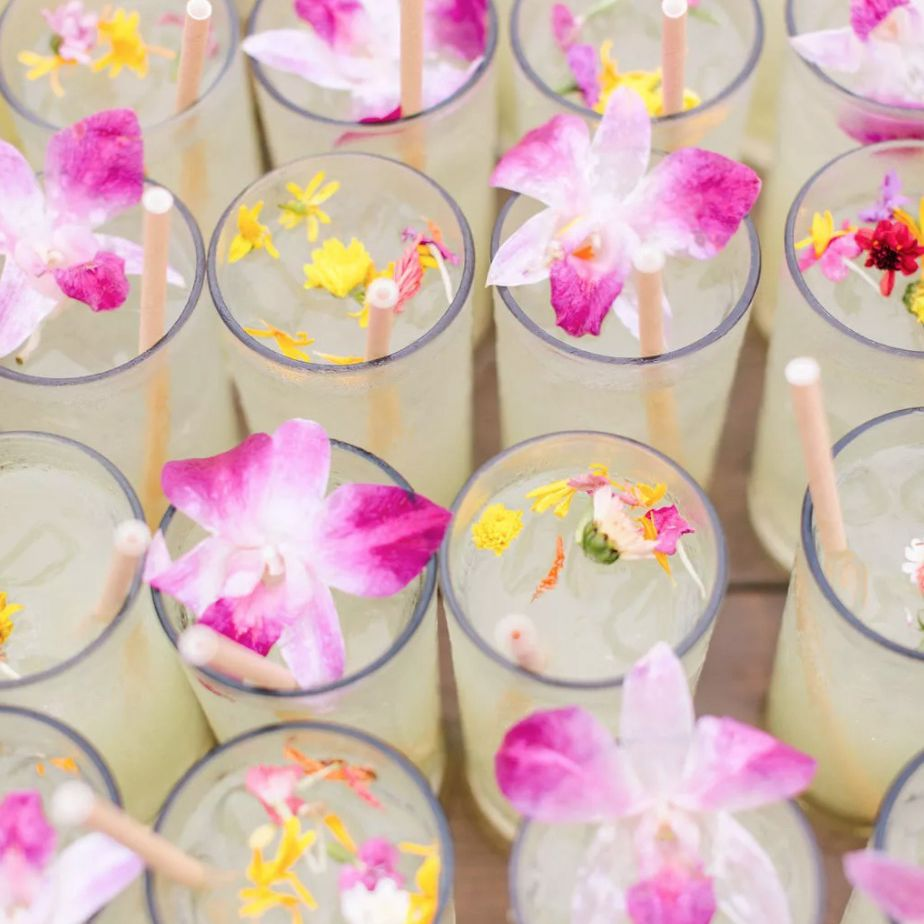 Signature drinks with floral garnishes
