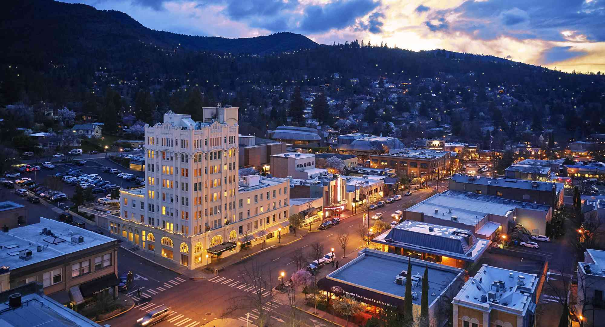 View of downtown Ashland at sunset with mountains