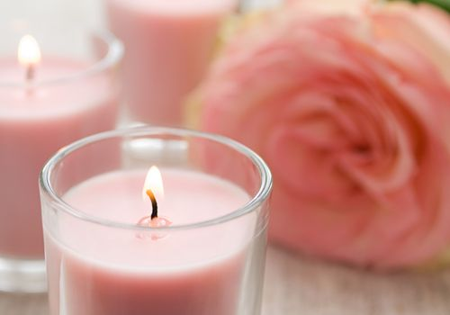 Pink votive candle with pink flower