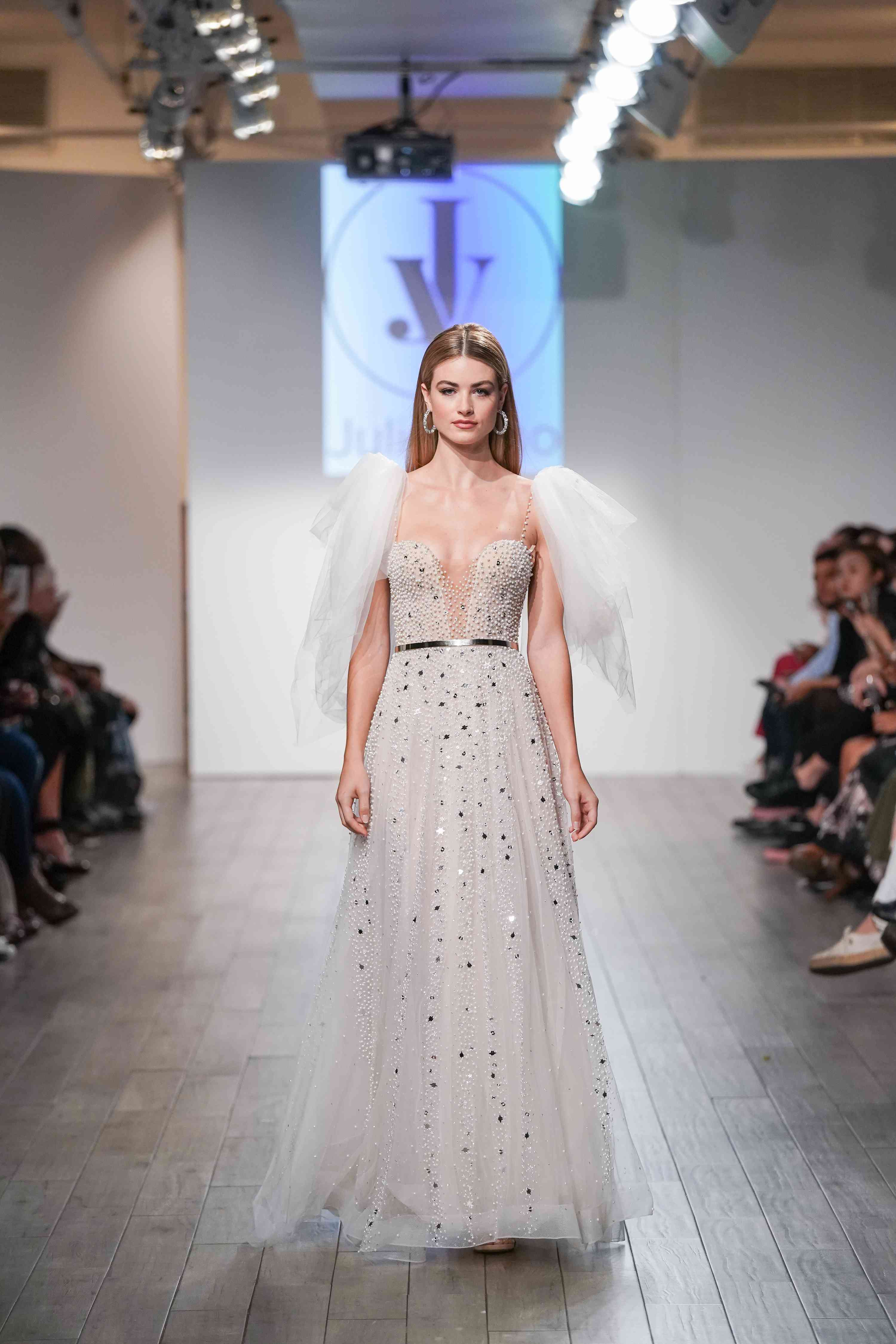 Model in embellished wedding dress with tulle sleeves
