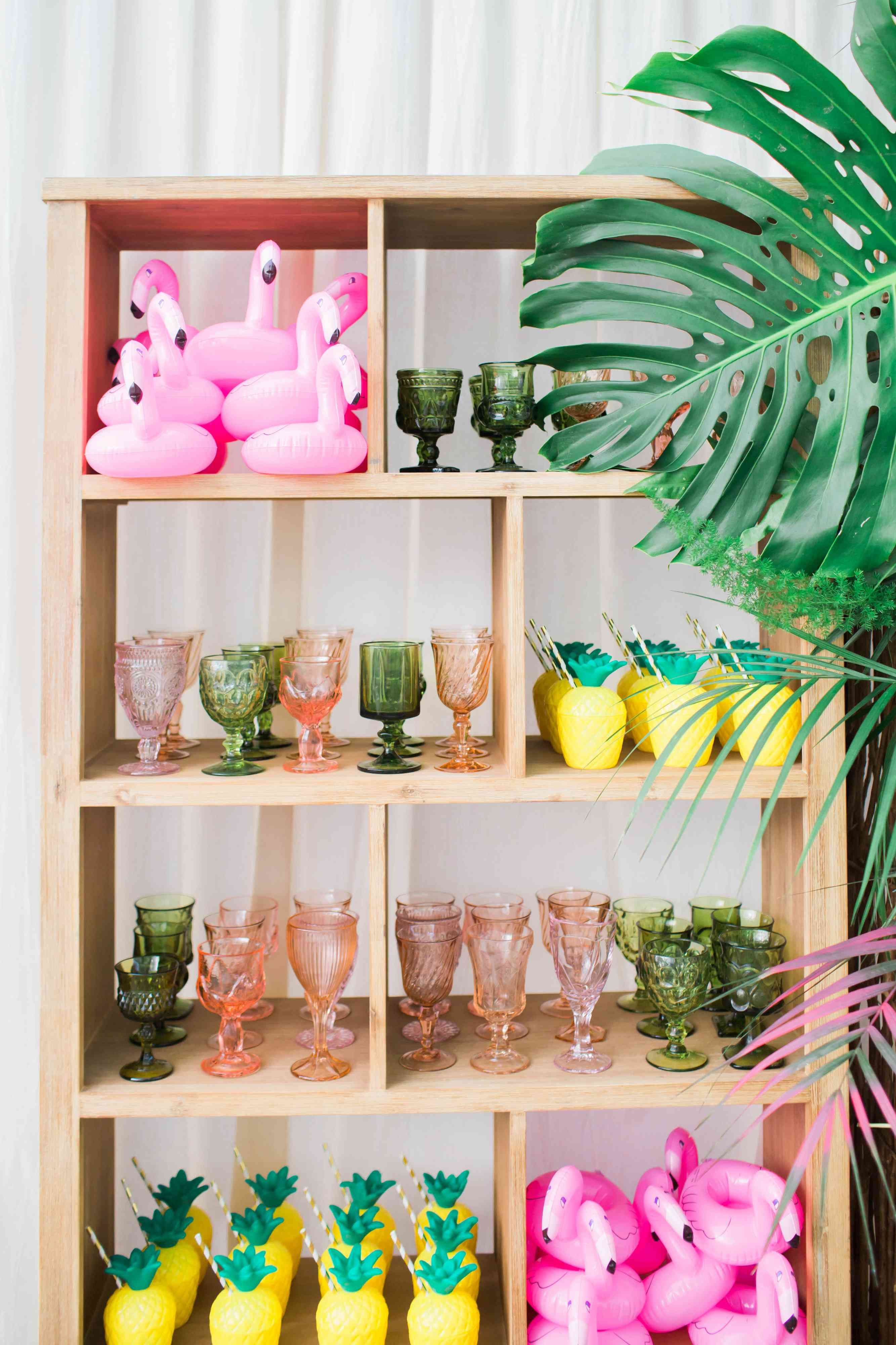 Glasses and blow up flamingo glassholders