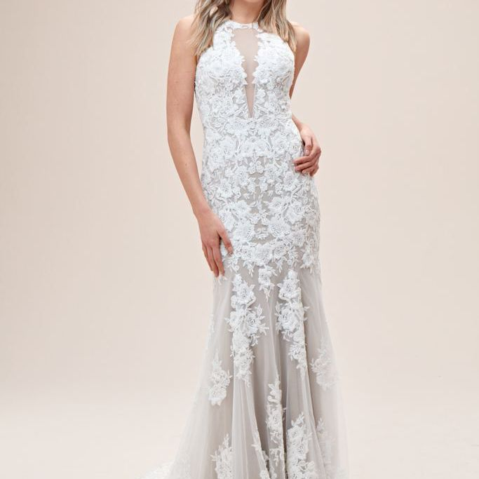Model in high-neck floral lace wedding gown
