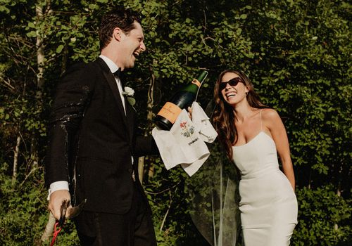 Couple popping champagne