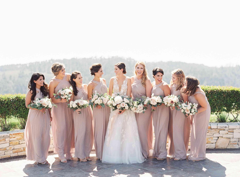 bridal party in blush bridesmaid dresses