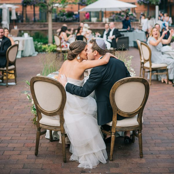 bride and groom kissing at jewish wedding