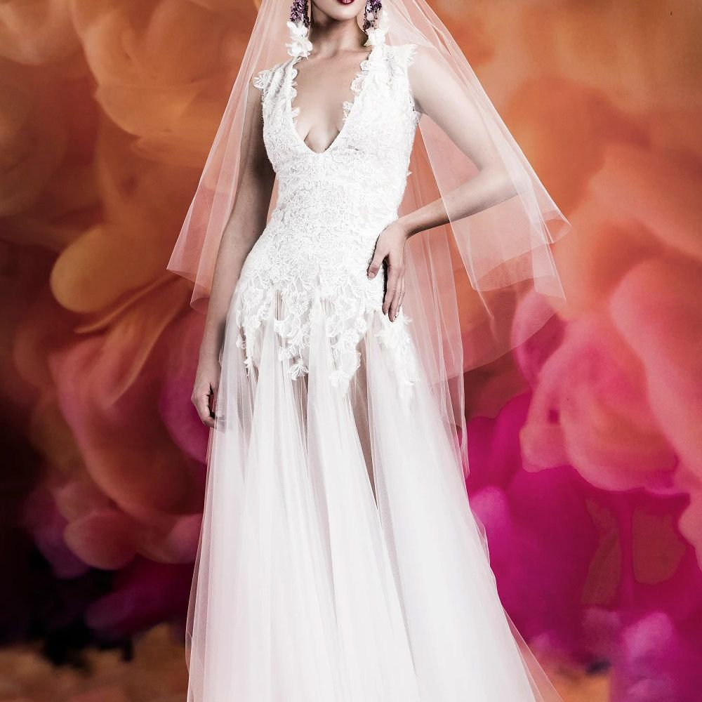 Model in plunging V-neck embroidered lace gown with tulle skirt