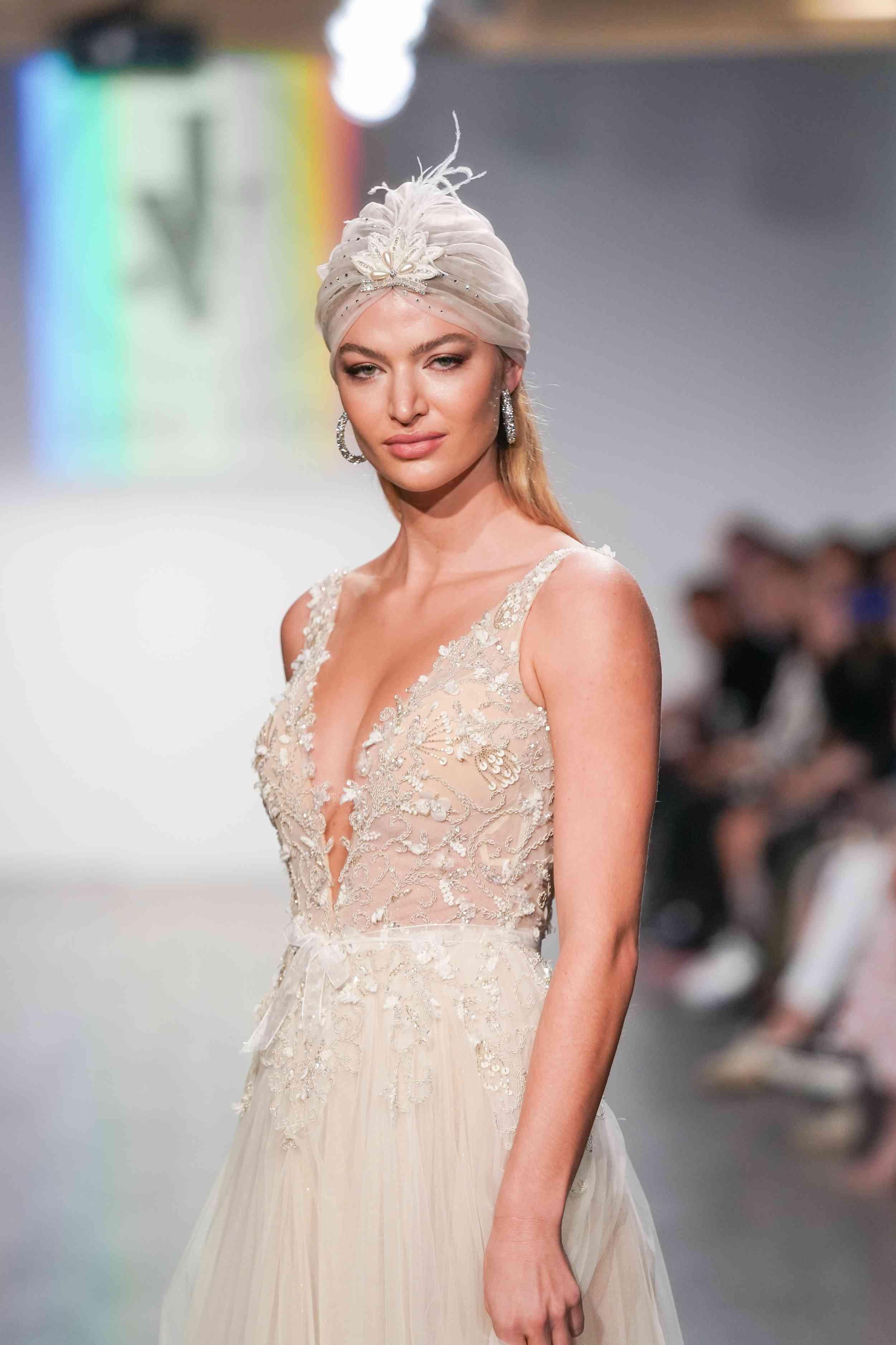 Model in sleeveless A-line wedding dress