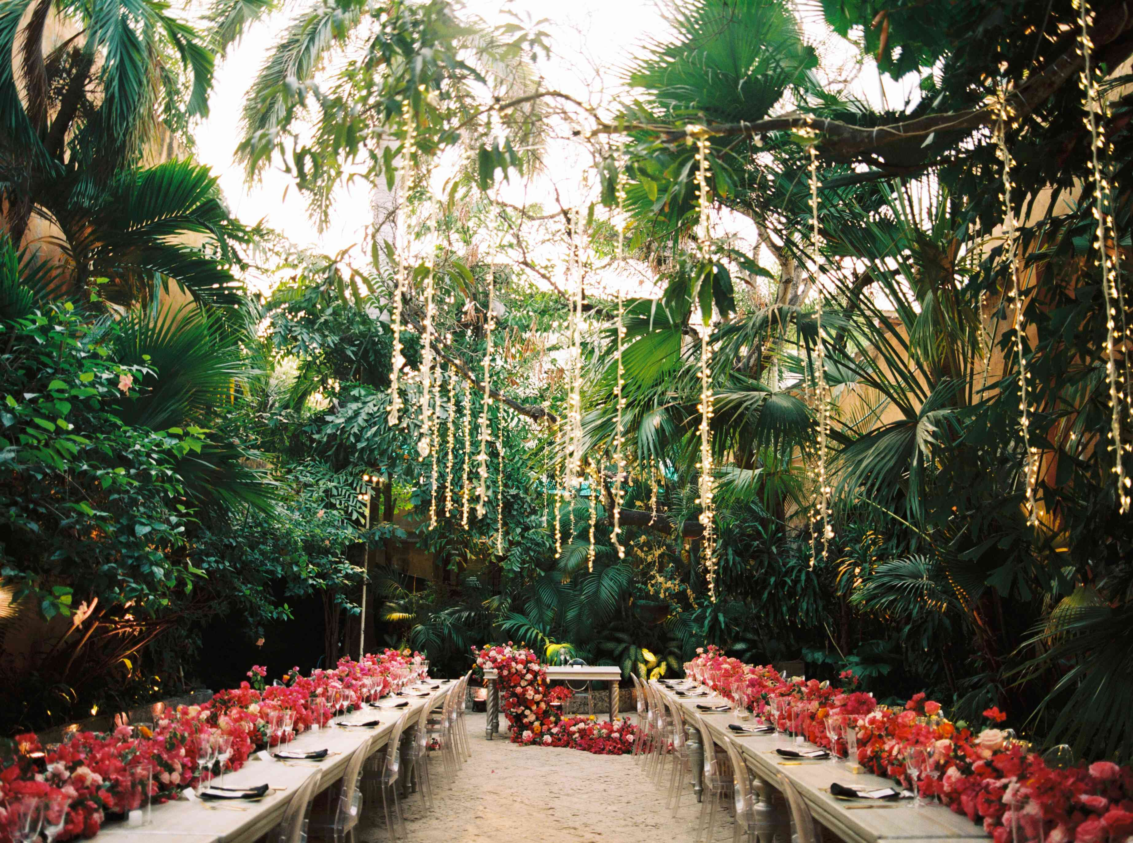 Glam sweetheart table with cascading floral runner