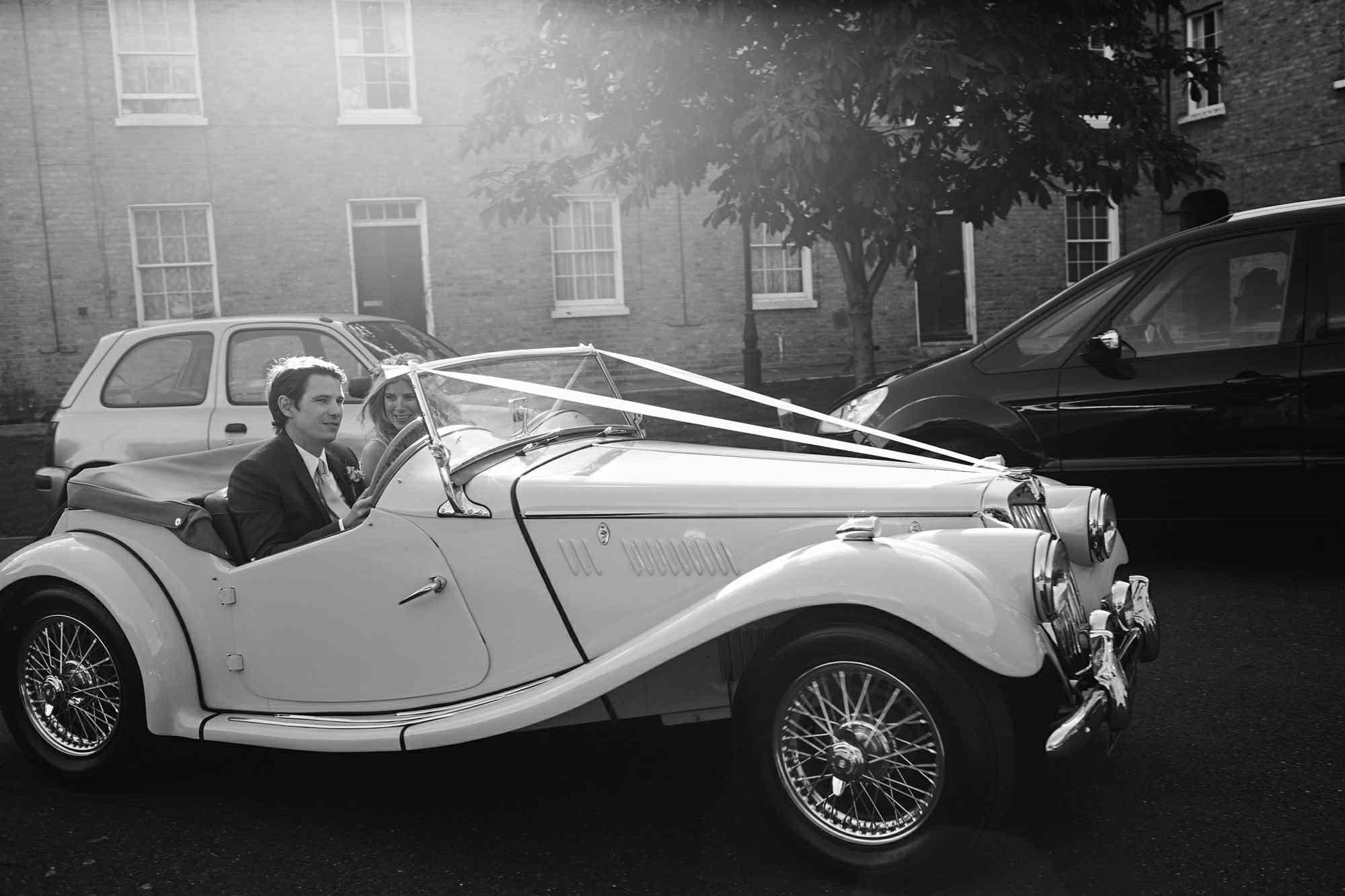 Newlyweds leaving in car