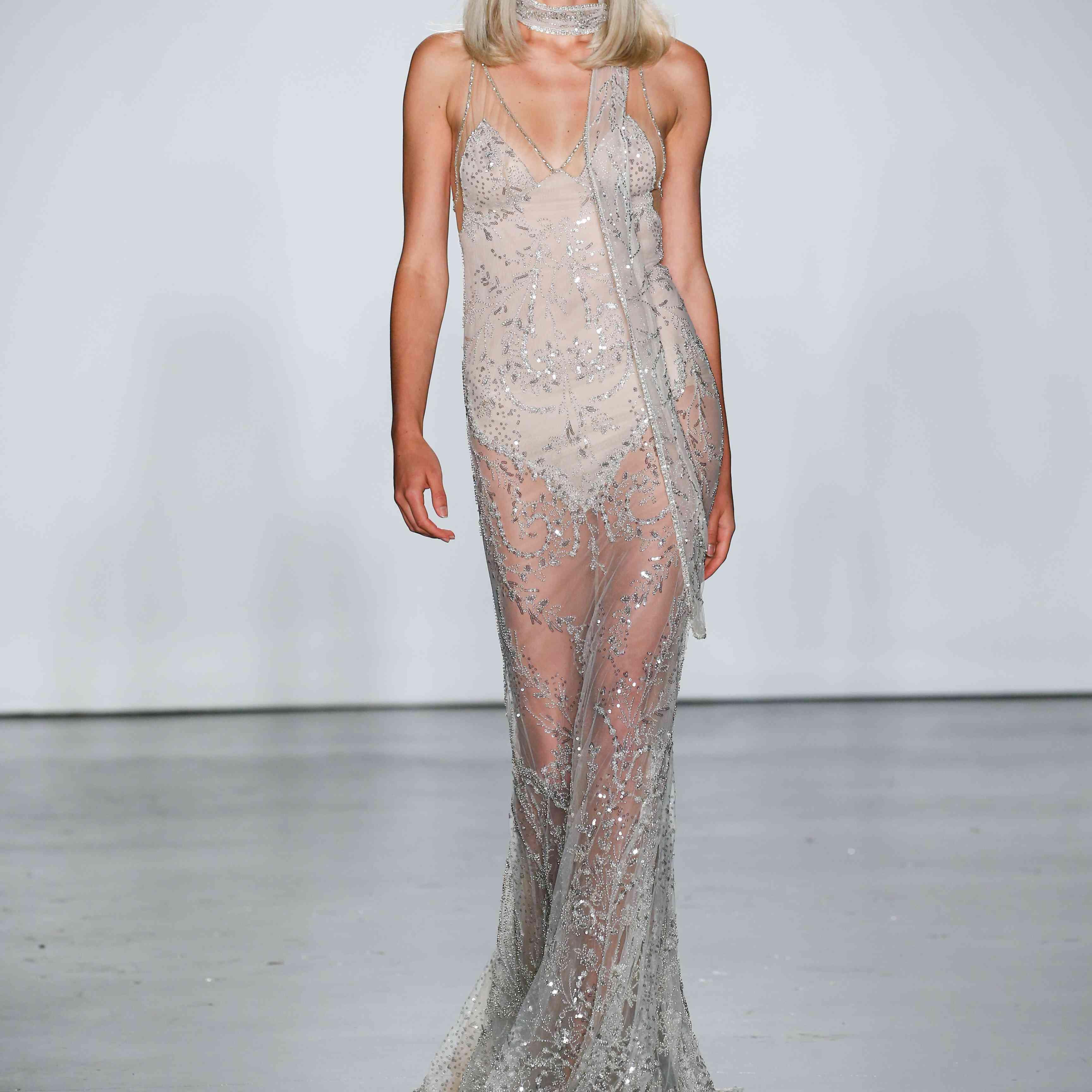 Model in sheer embellished sleeveless wedding dress