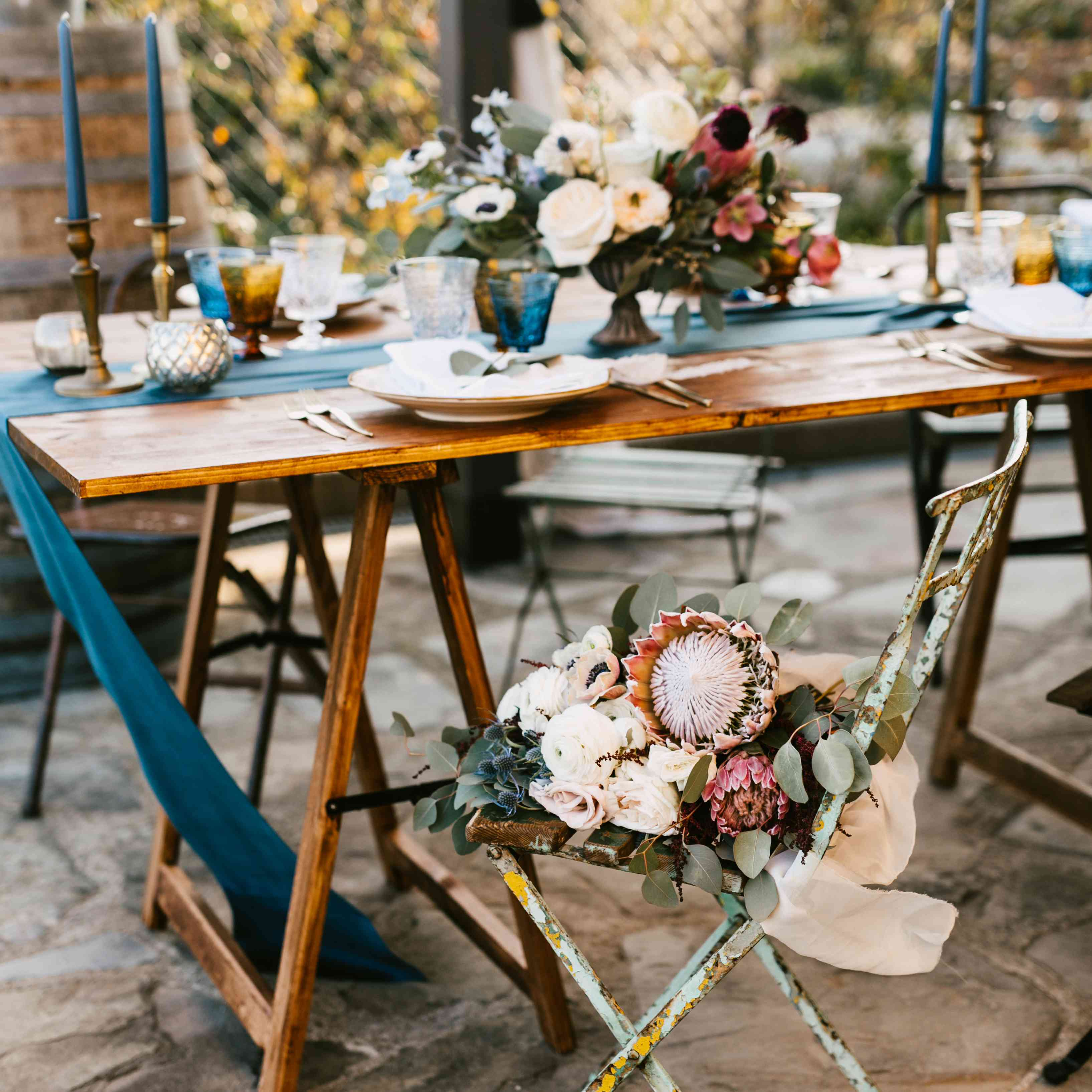 <p>tablescape florals colored tapered candles table runners</p><br><br>