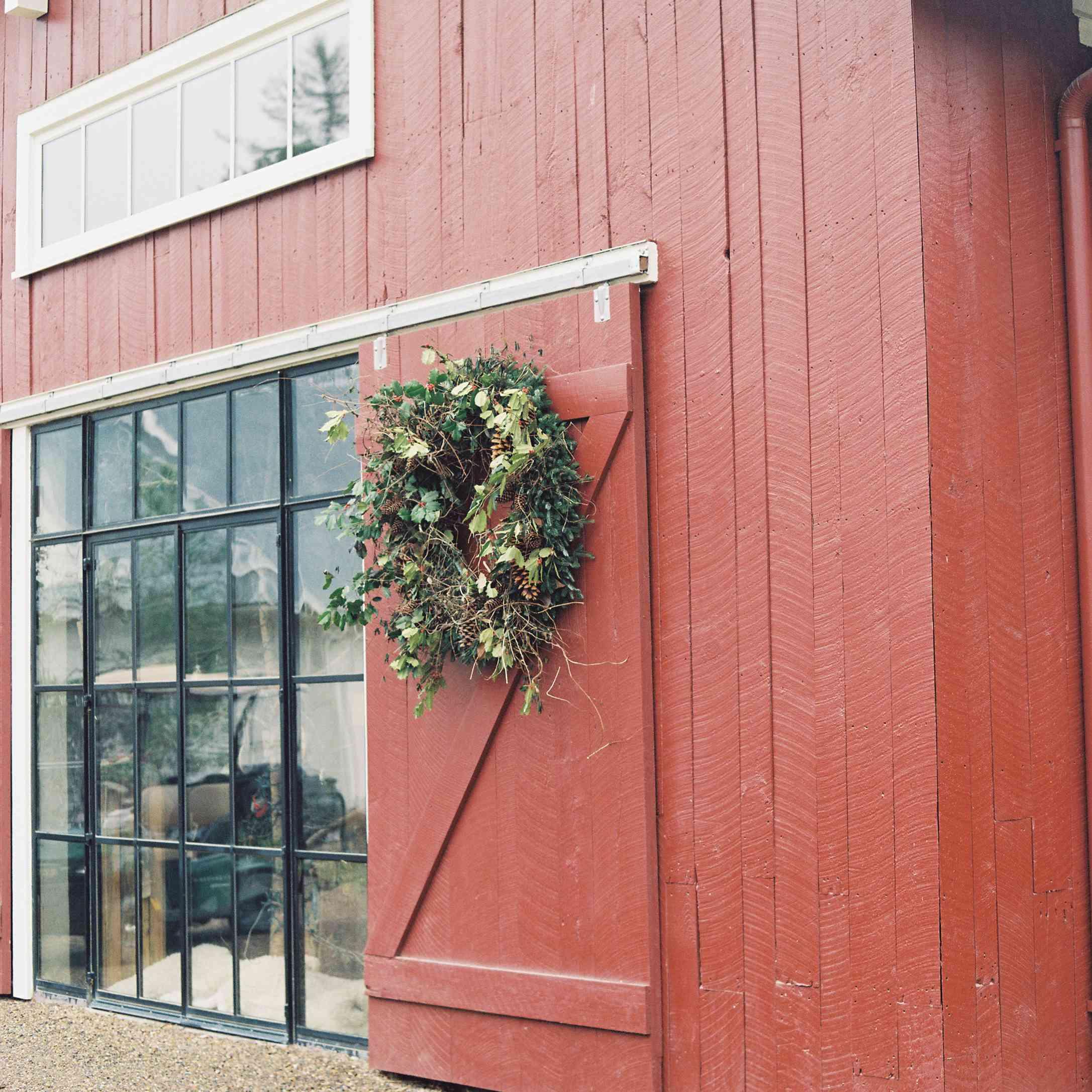 Red barn venue with seasonal greenery