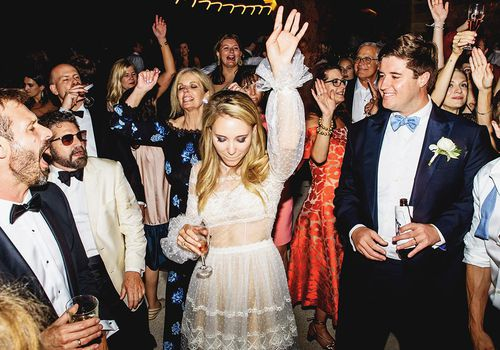 <p>Bride and groom dancing at reception</p>