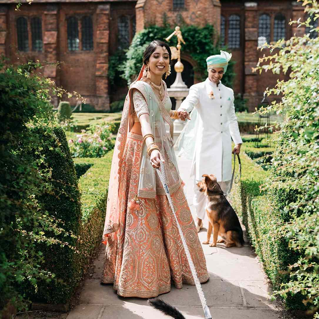 bride and groom walking their dogs