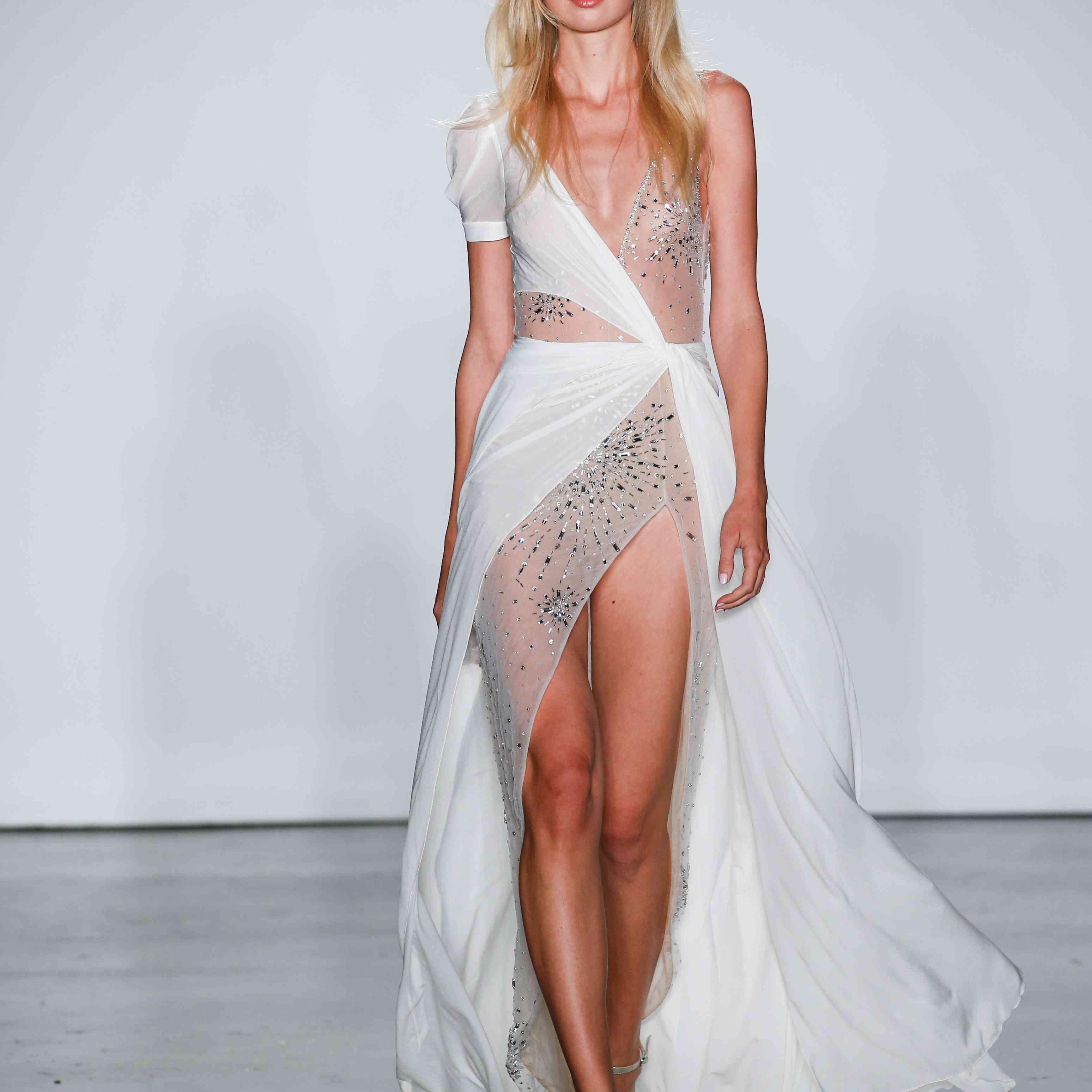 Model in asymmetric wedding dress with slit