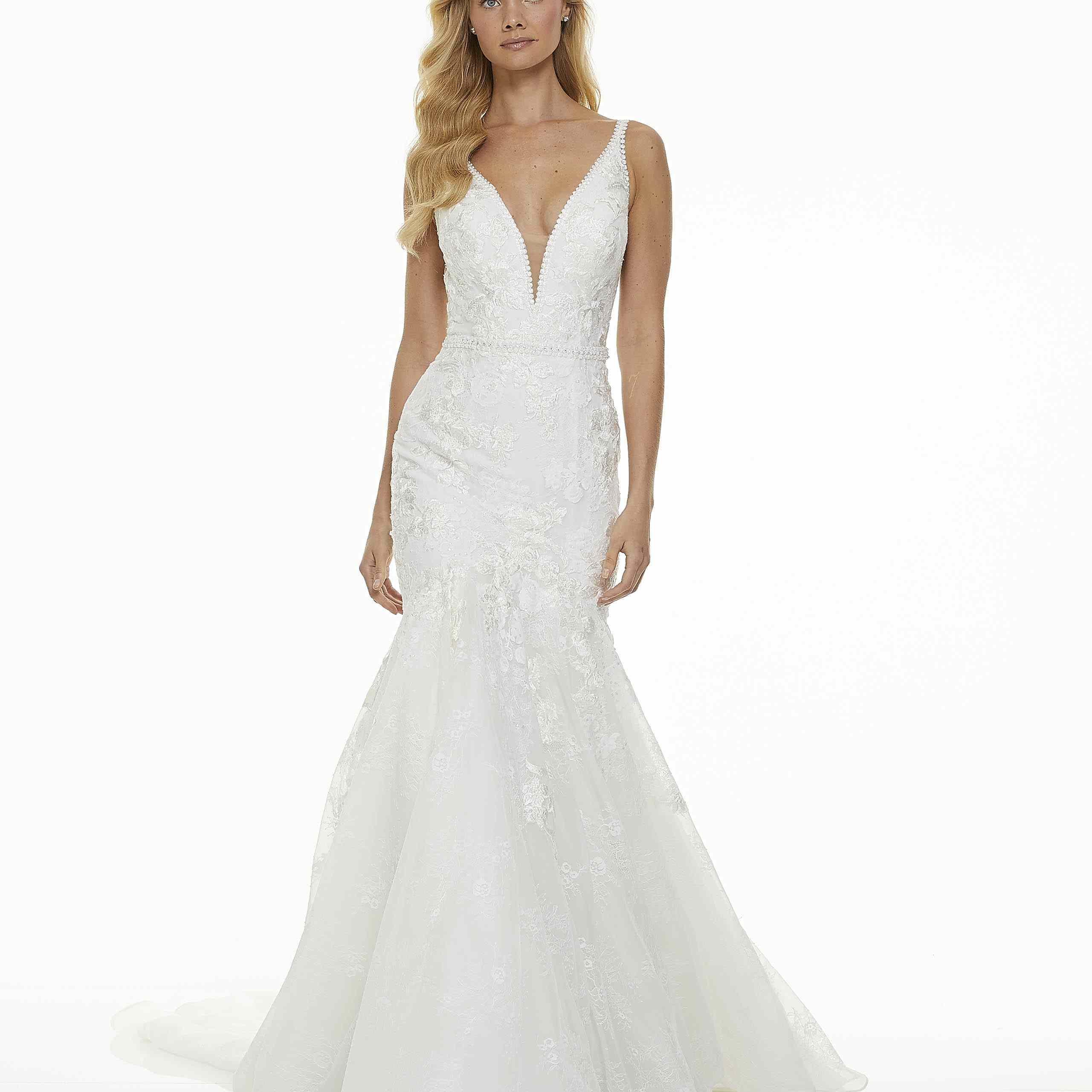 Model in mermaid wedding dress with plunging neckline
