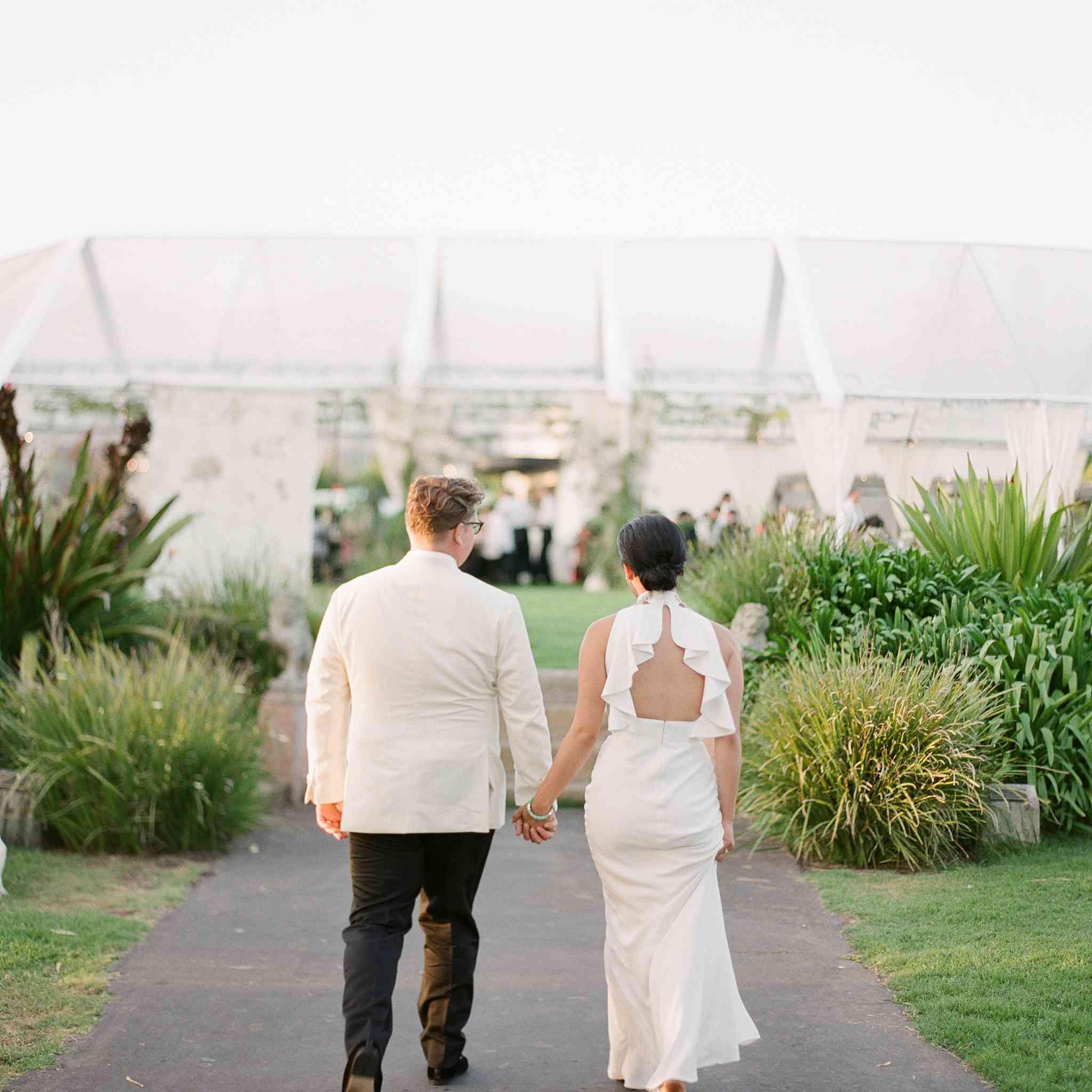 Bride and groom walking towards reception