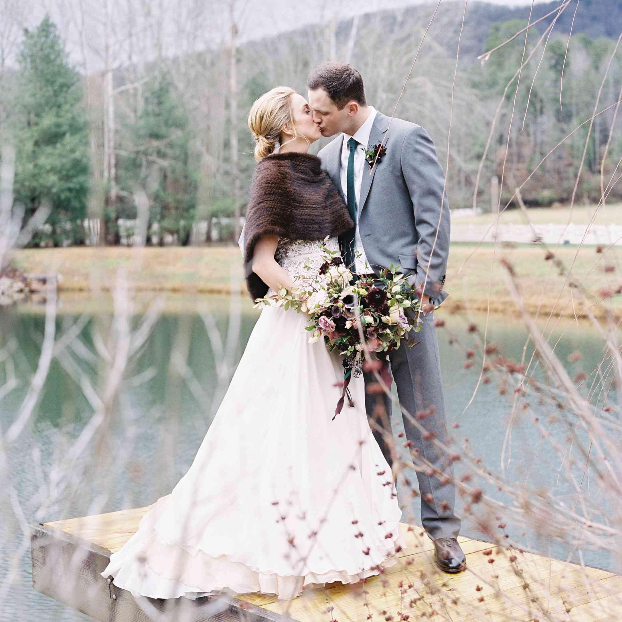 fur caplet bride and groom kissing
