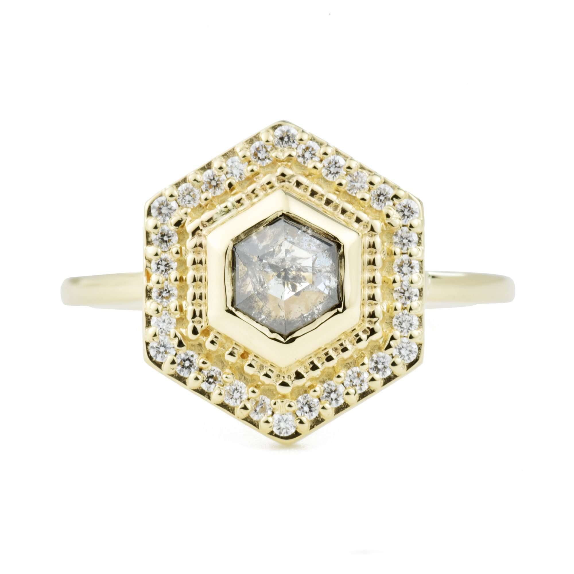 Hexagon salt and pepper diamond in a bezel setting with milgrain and a diamond halo in rose gold