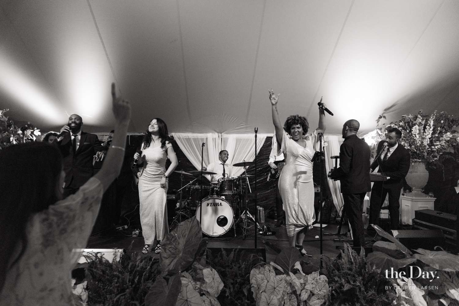 Performers on stage at a wedding reception