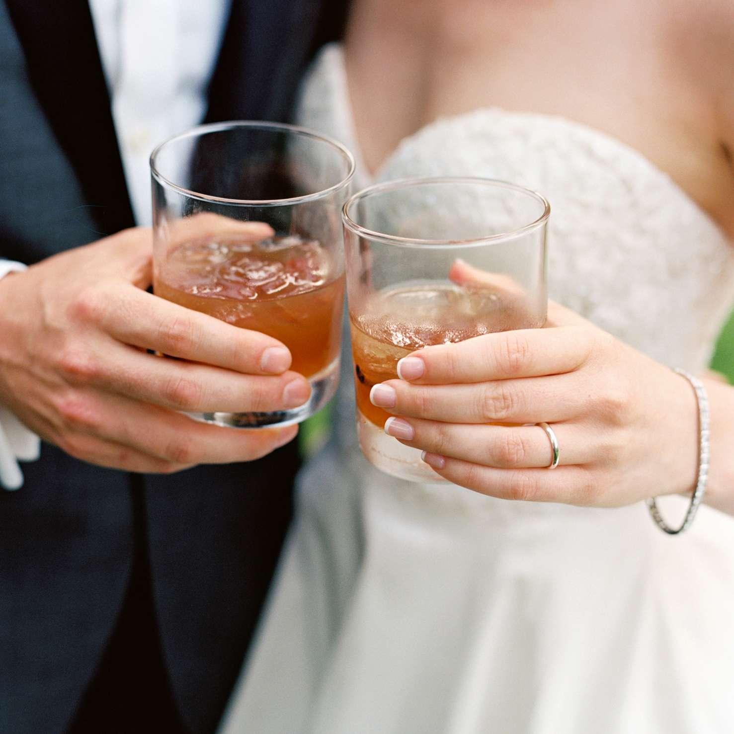 Newlyweds holding cocktails