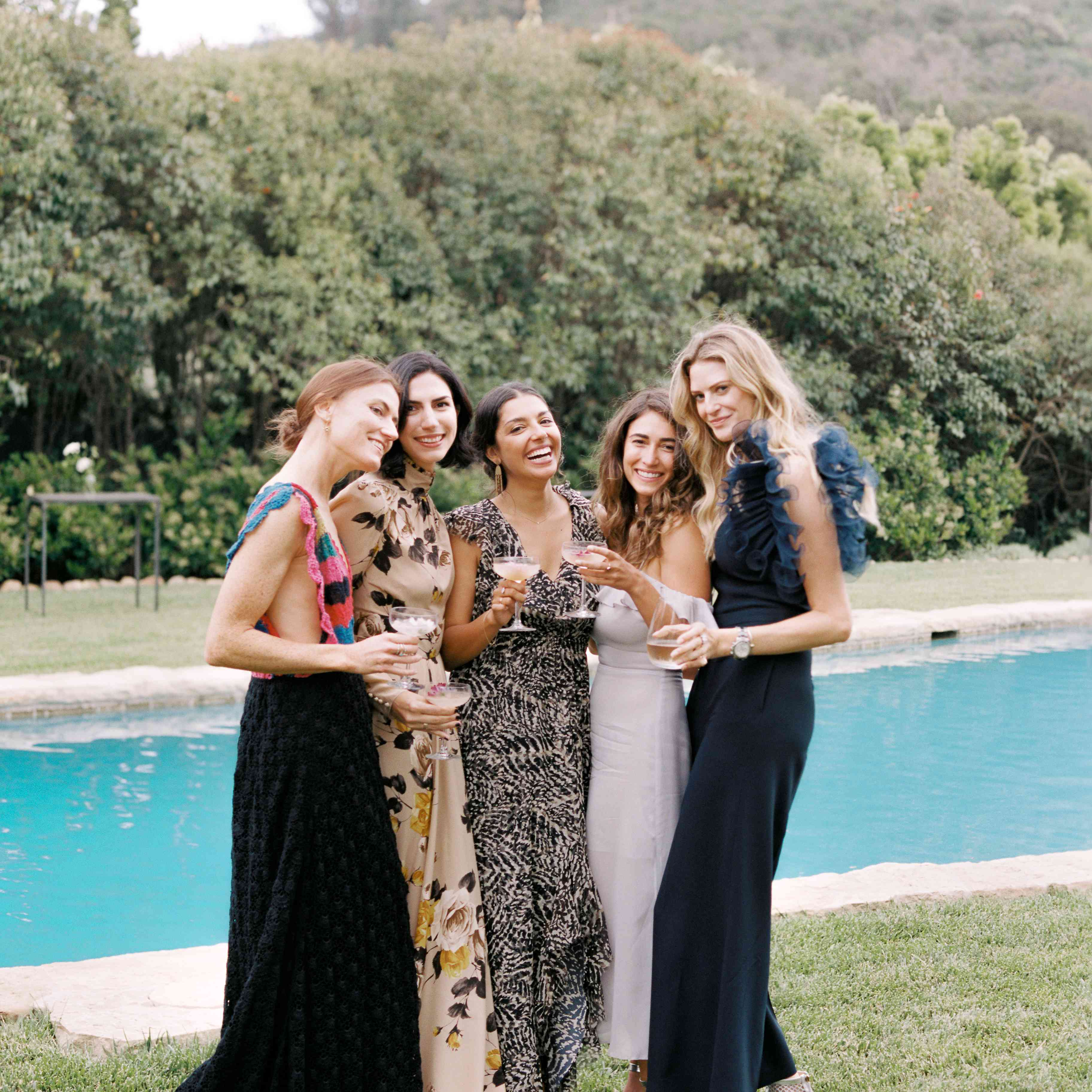 wedding guests in maxi dresses