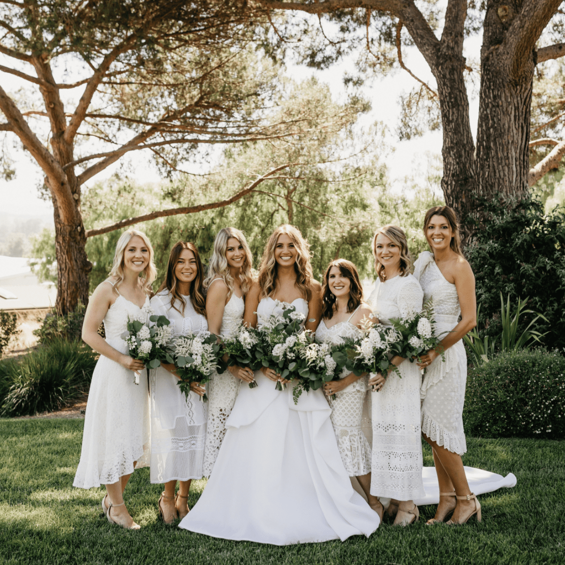 Bride with bridal party in white