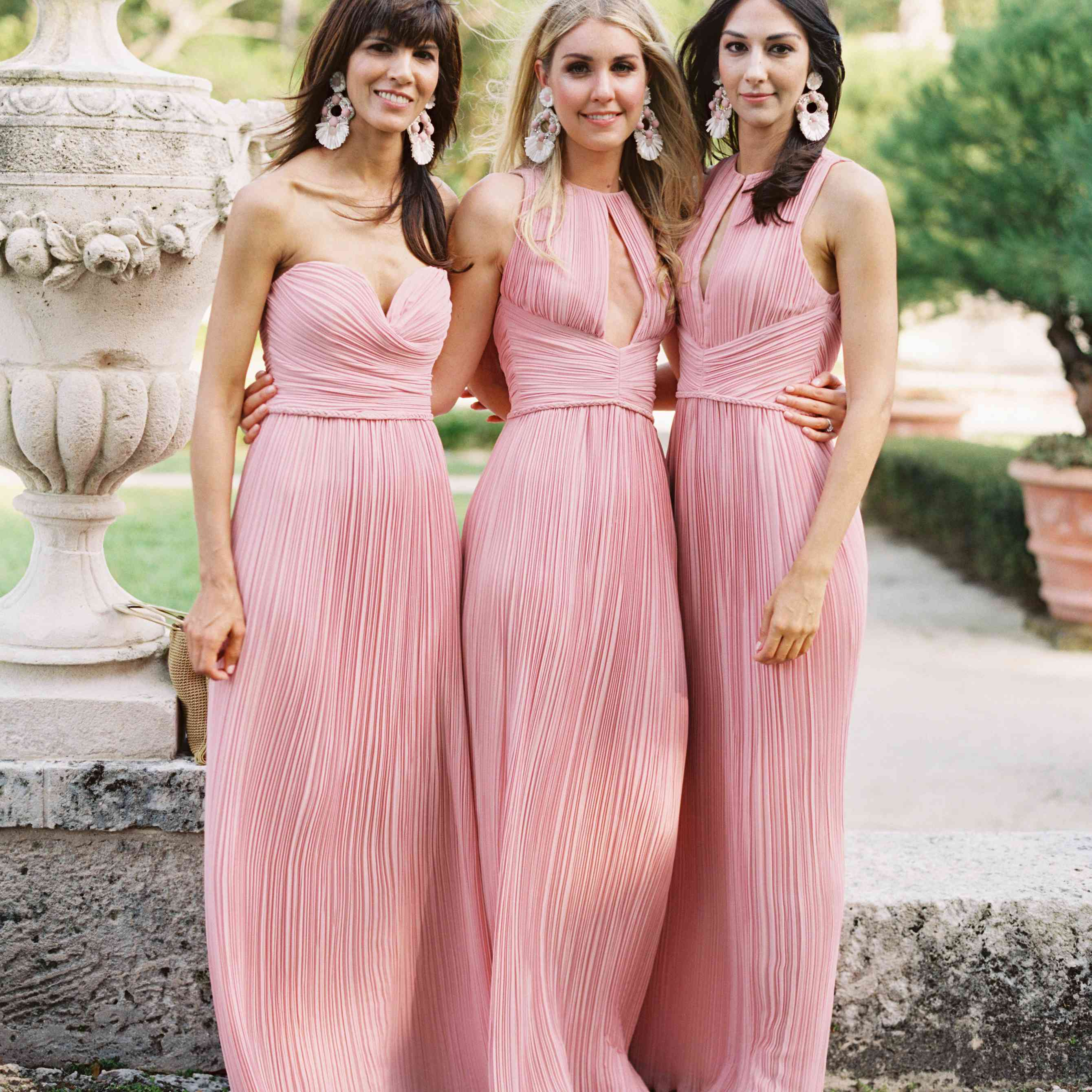 Bridesmaids in Pink Pleated Dresses