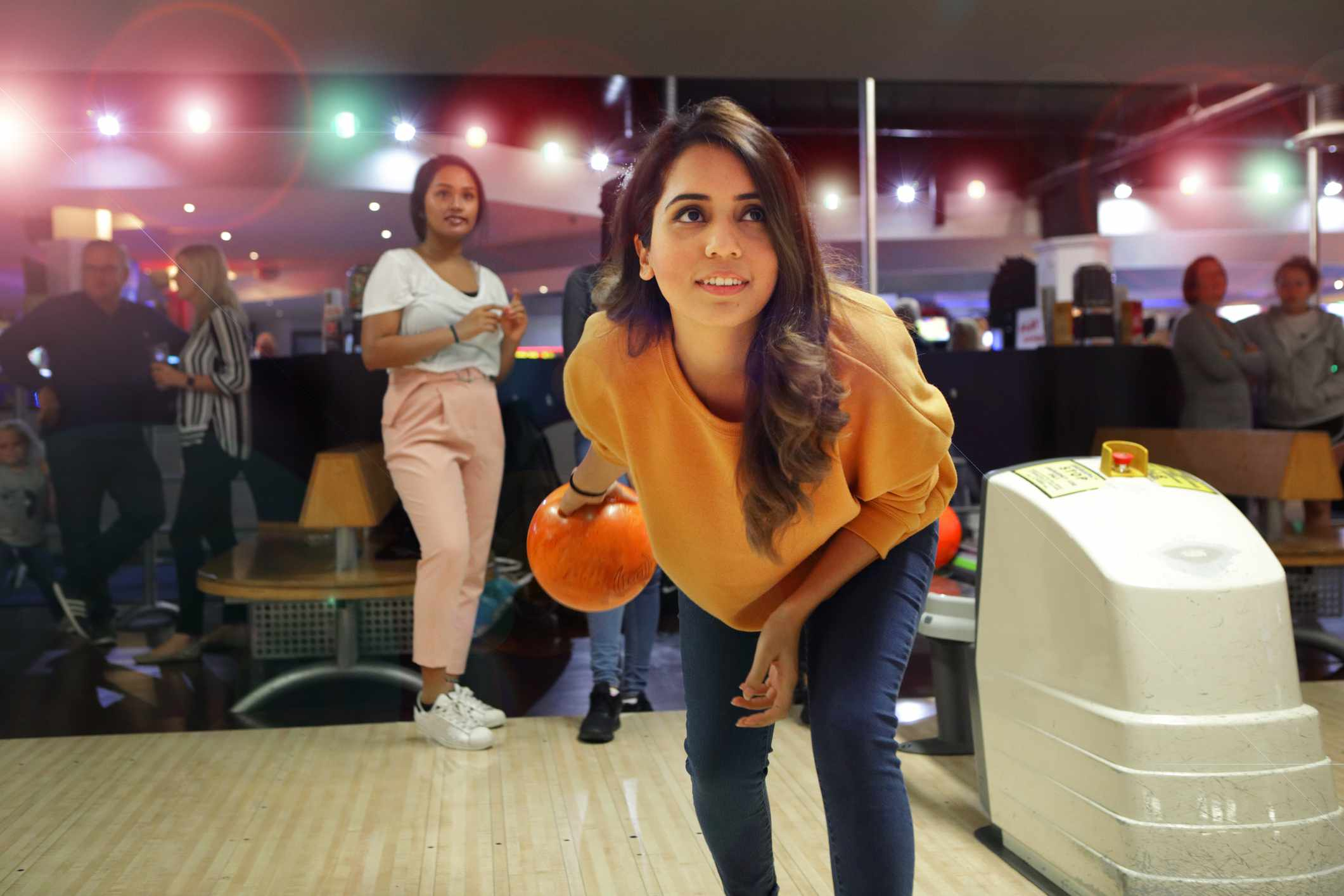 Young people in bowling alley