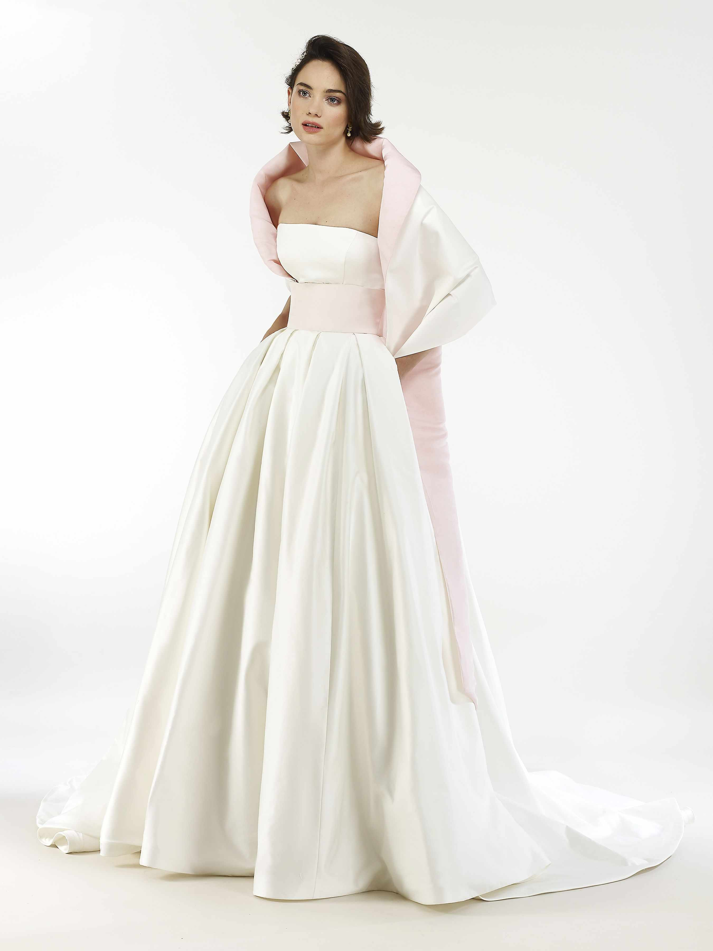 Model in strapless ballgown with pink waistband and shawl wrap