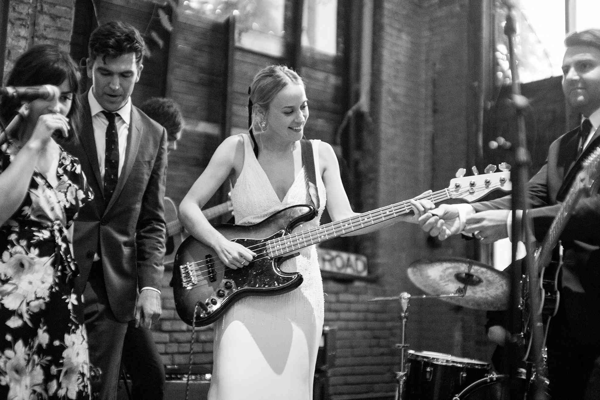 <p>bride playing the guitar live band</p><br><br>