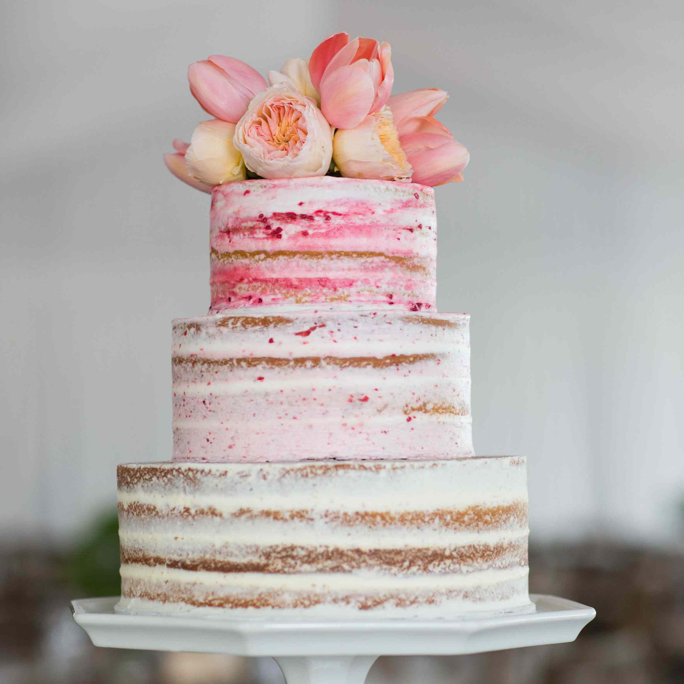 Naked wedding cake with pink ombre frosting