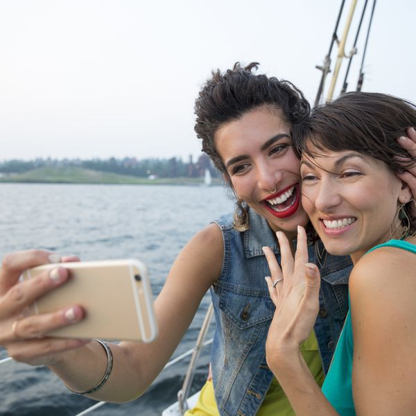 engaged couple taking a selfie