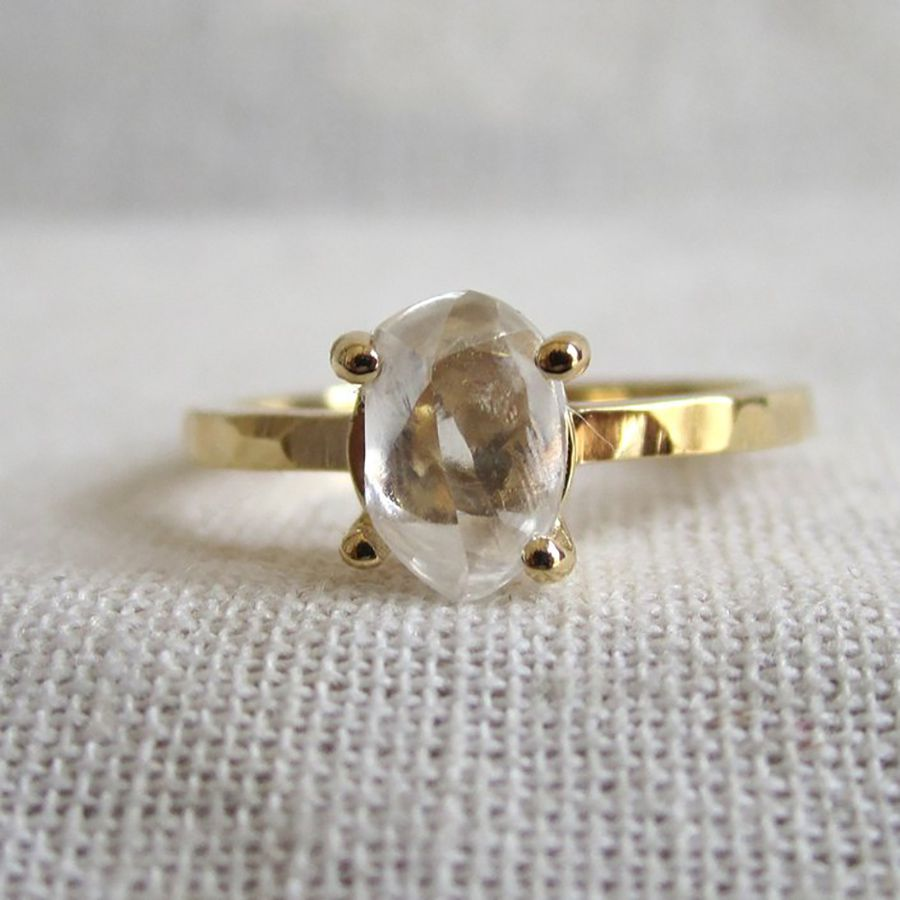 Gold ring with rough diamond in a four prong setting