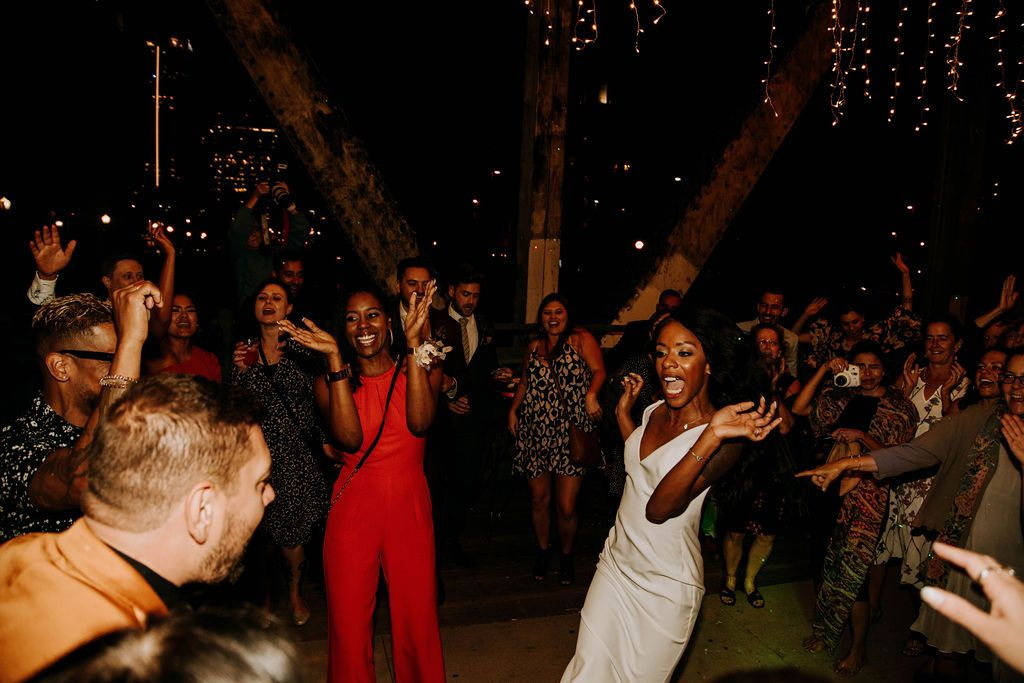 People dancing at a night wedding reception