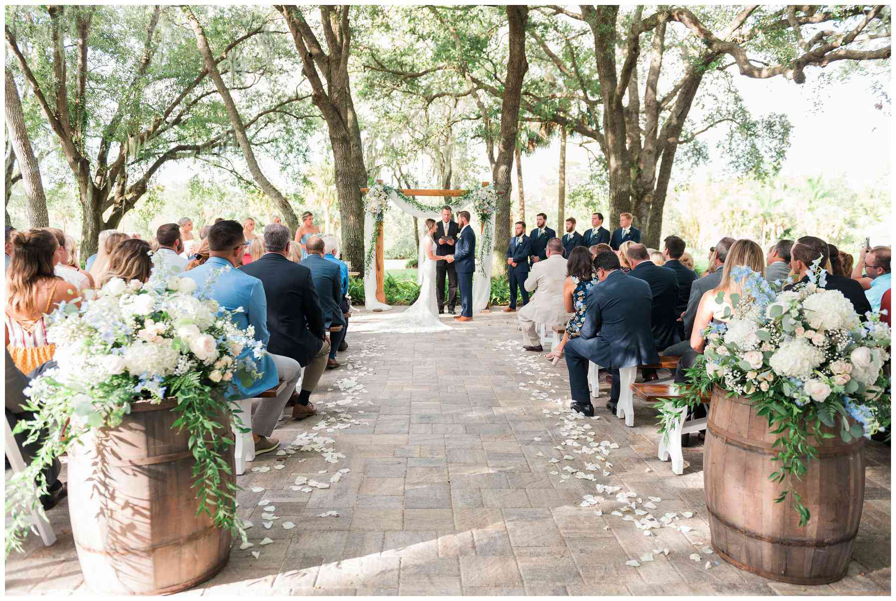 Wedding ceremony under oak canopy at Up the Creek Farms in Melbourne