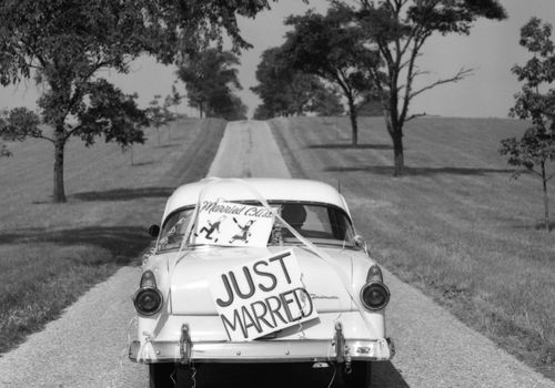 "Back of car with ""just married"" sign"