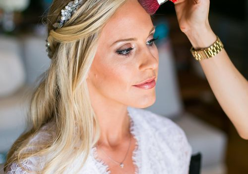 Bride getting her wedding-day makeup done.